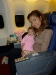 Essa and me sitting at the bulkhead on our red eye flight to London from Dallas