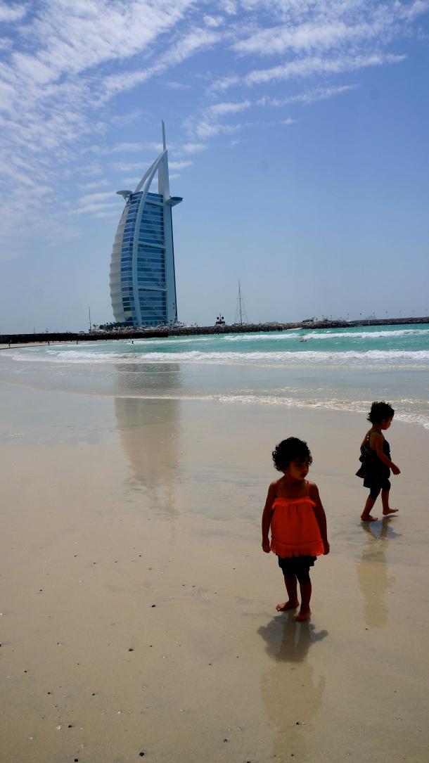 The traveling twins at Burj Al Arab, Dubai. Have twins, will travel.